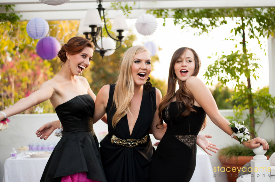 Three girls in black dresses excited for prom