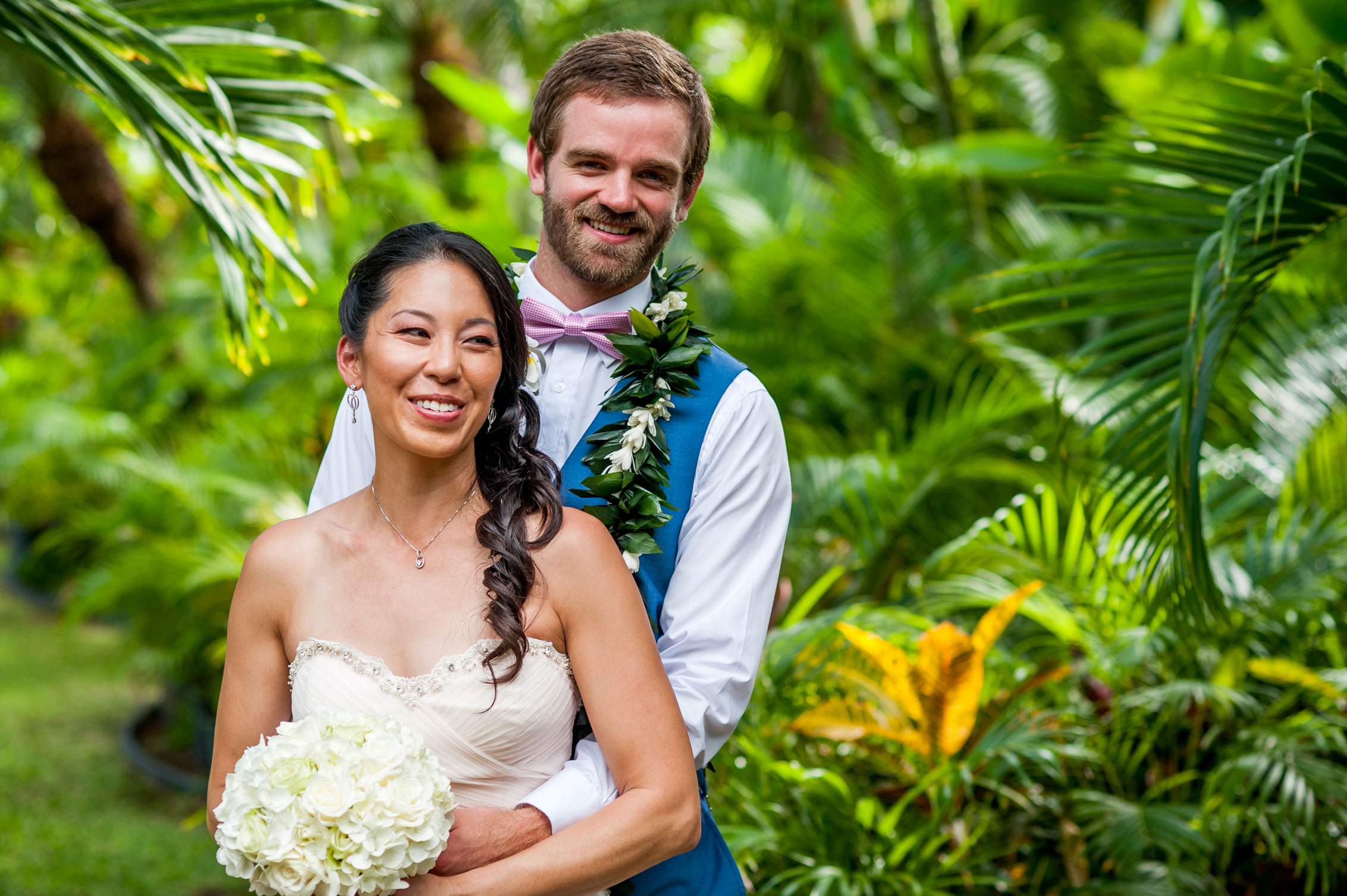 wedding couple embracing in hawaii lush greenery
