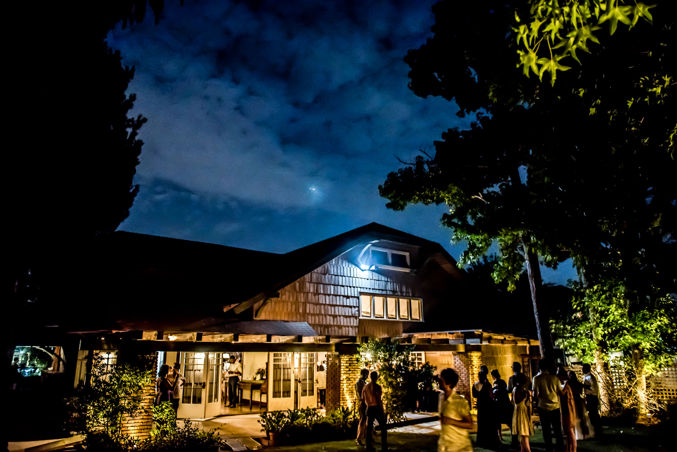 womens twentieth century club wedding at night with moonlit sky