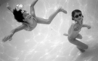 two girls swimming underwater
